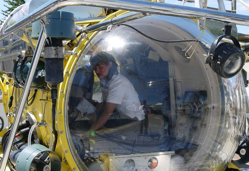 Submarine pilot Erika viewed through Antipodes dome at surface